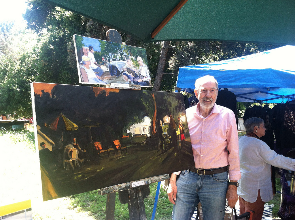 Don Normark stands in front of the painting by his Highland Park friend Carol Colin.