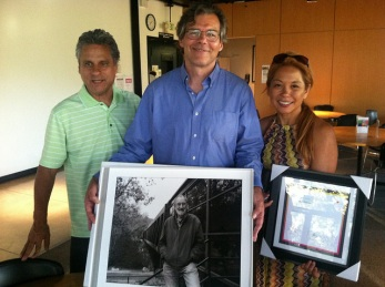 At Pasadena's Art Center College of Design, Gil Ortiz (Don's good friend), Benjamin Normak (Don's son) and Roz Duavit Pasion (Don's partner) pose with a photo of Don at Art Center.